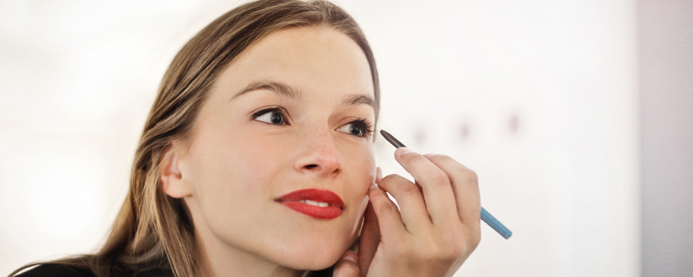 Woman is doing the make up