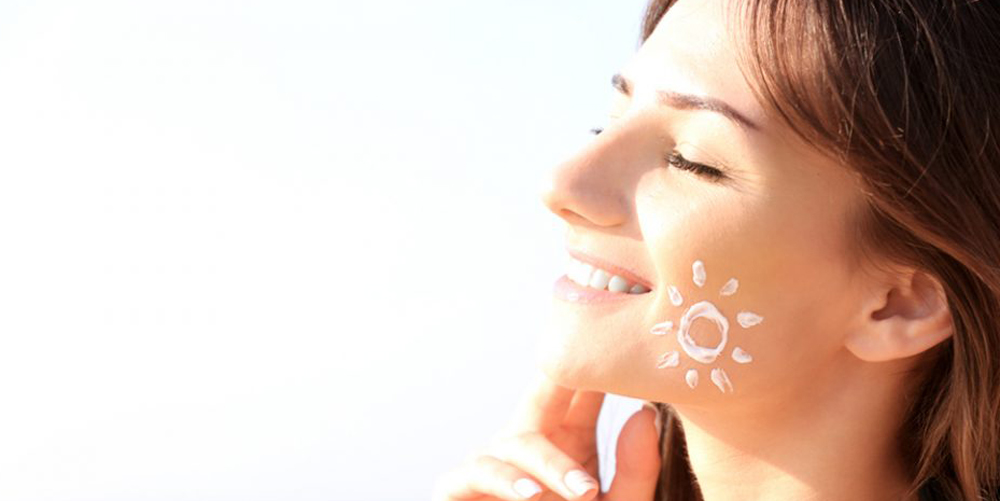 Woman with sunscreen on face