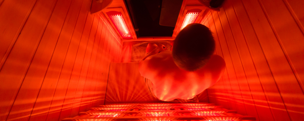 Man relaxing in a luxury infrared sauna.