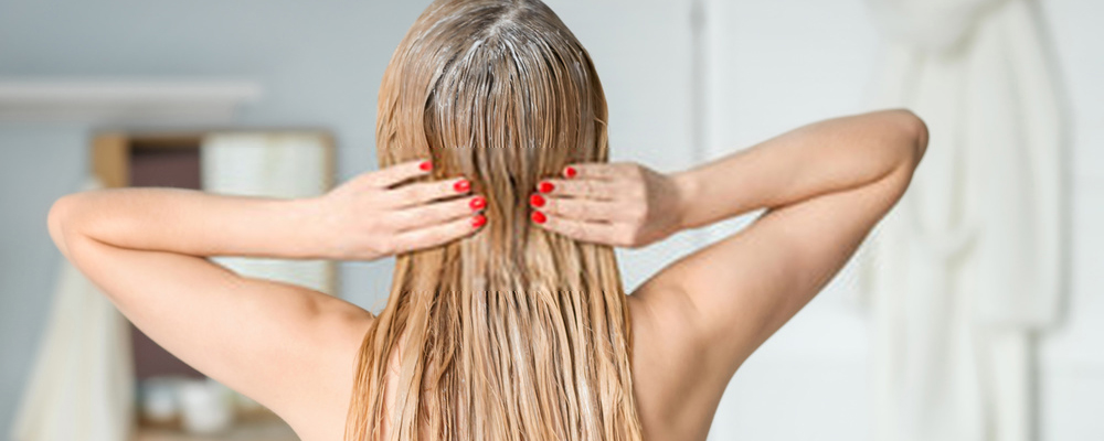 Woman using hair conditioner