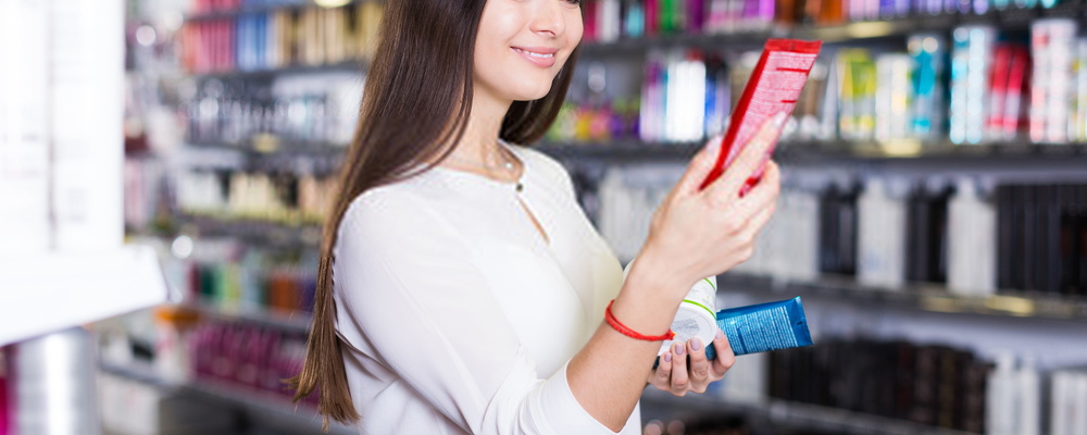 Woman choosing hair conditioners